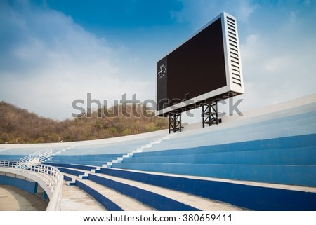 Blank scoreboard in outdoor stadium - stock photo