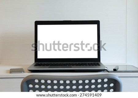 blank screen laptop computer is on wooden desk as workplace concept - stock photo
