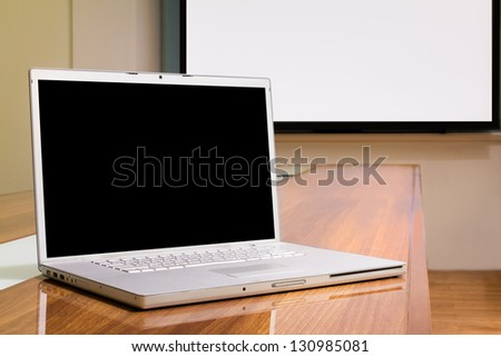 Blank screen laptop in conference room, meeting room, boardroom, Classroom, Office. - stock photo