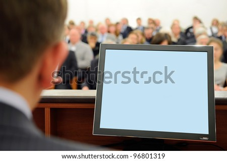 Blank screen of speaker's computer. - stock photo