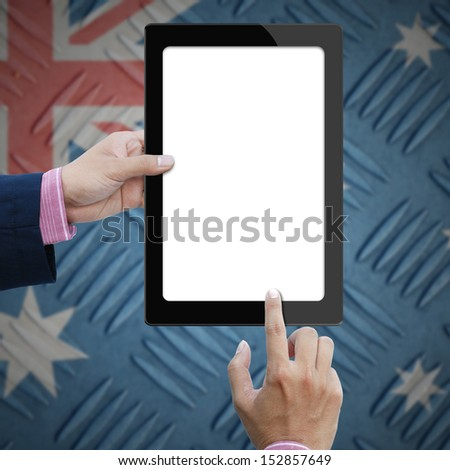 Blank screen tablet computer in business hand on australia flag background. - stock photo