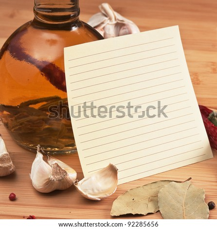 blank sheet for cooking recipes and spices on a wooden table - stock photo
