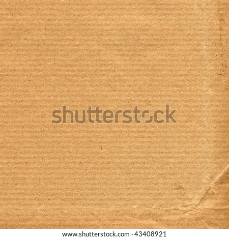 Blank sheet of brown paper useful as a background - stock photo
