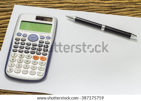 Blank sheet of calculator pens and pencil. - stock photo