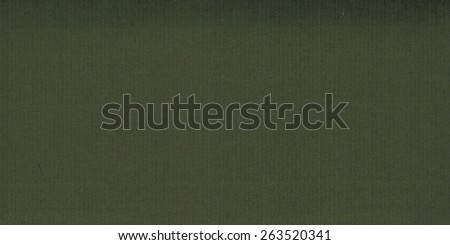 Blank sheet of dark green paper useful as a background - stock photo