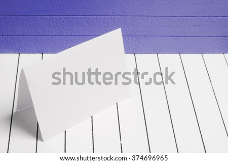 Blank sheet of paper against a background  white wood - stock photo