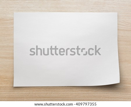 Blank sheet of paper on wooden background - stock photo