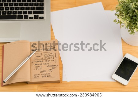 Blank sheets, smartphone, laptop and website development project on the tablet of designer - stock photo