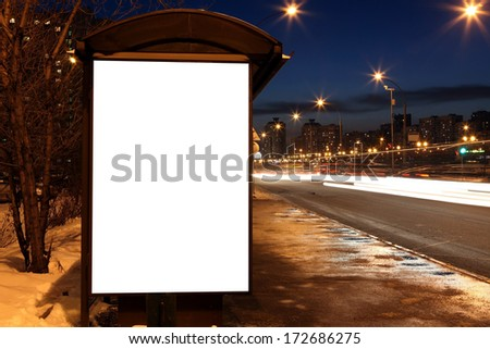 Blank sign at bus stop in evening city - stock photo