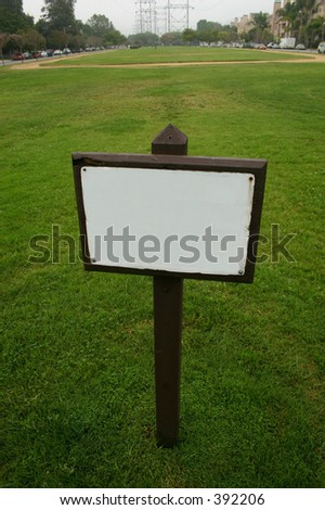 Blank sign in a park - stock photo