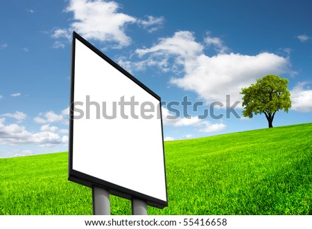 Blank sign on green field