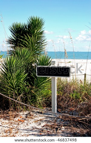 blank sign on pole Sanibel Florida beach - stock photo