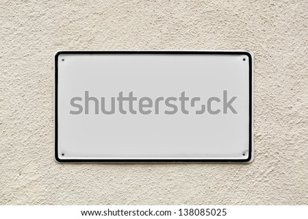 Blank sign on the wall - stock photo