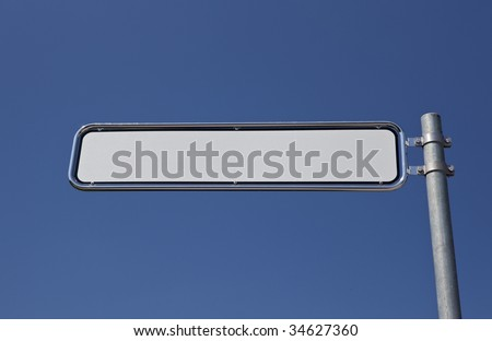 blank signpost, blue sky in the background - stock photo
