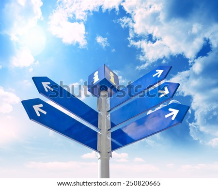 Blank signpost with  arrows over blue sky - just add your text - stock photo