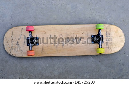 blank skateboard on the ground - stock photo