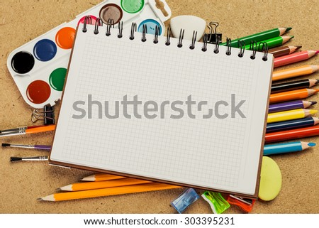 Blank sketch book and drawing tools - stock photo