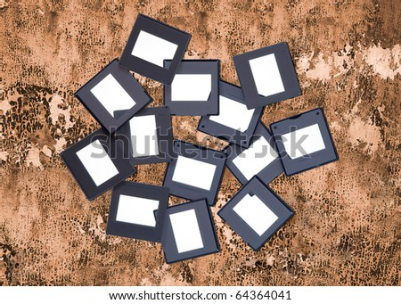 Blank slides on grungy background, picture frames - stock photo