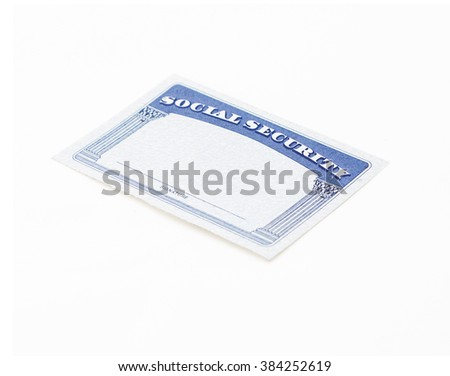 Blank social security card on a light grey background. Selective focus.