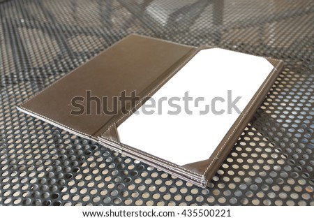 Blank Space of Leather Restaurant Bill Receipt Holder  - stock photo