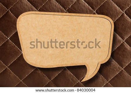 Blank Speech Bubble on Brown leather Background - stock photo