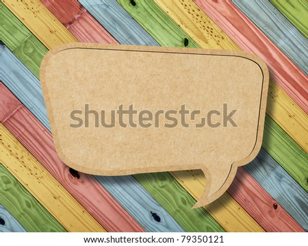 Blank Speech Bubble on colorful painting wood background - stock photo