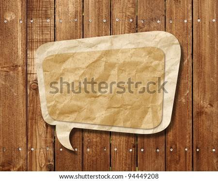 Blank Speech Bubble on wood background - stock photo