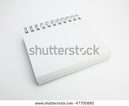 Blank spiral memo pad with natural white background - stock photo