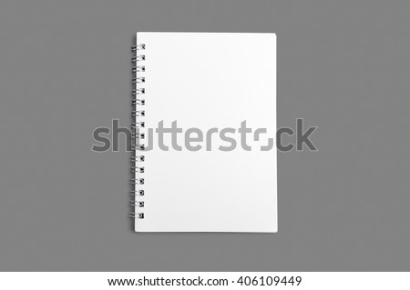 Blank spiral notebook isolated on gray background - stock photo