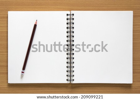 blank spiral notepad and pencil on wood background - stock photo