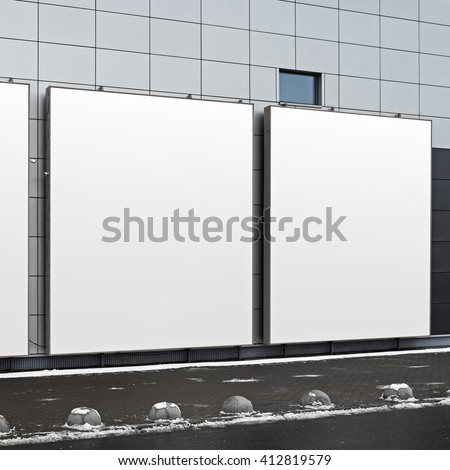 Blank square billboards on the facade of a modern building. Isolated with clipping path. Blank template for design presentations and portfolios. - stock photo