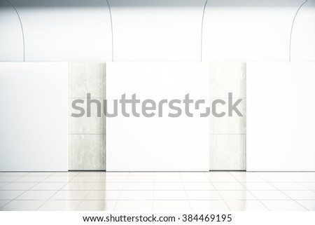 Blank square posters on concrete wall in empty hall, mock up,  - stock photo