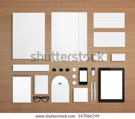 Blank Stationery and Corporate ID Template. Consist of Business cards, letterhead a4, Tablet PC, usb flash drive, bages, pen, envelopes, glasses, tube, folder, notes and smart phones. - stock photo
