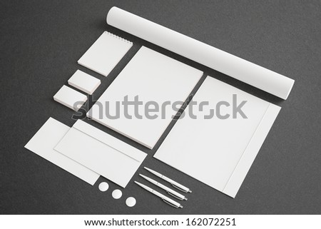 Blank Stationery Corporate ID set on dark background with soft shadows. Consist of Business cards, A4 letterheads, envelopes, notebook, tube, pens and folder. - stock photo