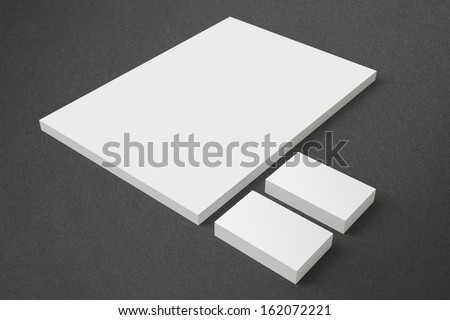 Blank Stationery on dark background with soft shadows. Consist of Business cards and A4 letterheads. - stock photo