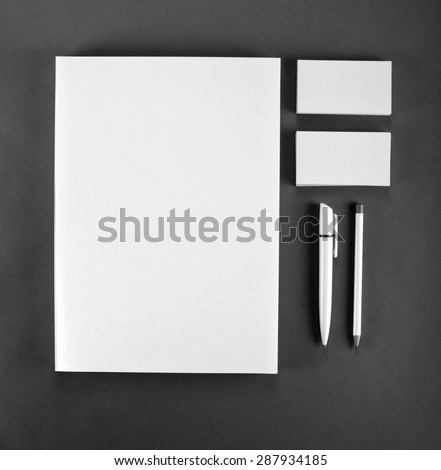 Blank Stationery on gray background. Consist of Business cards, A4 letterheads, pen and pencil - stock photo