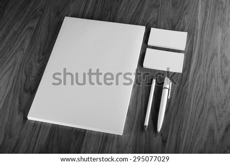 Blank Stationery on wooden background. Consist of Business cards, A4 letterheads, pen and pencil - stock photo