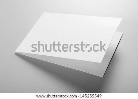 Blank stationery: postcard over gray background - stock photo