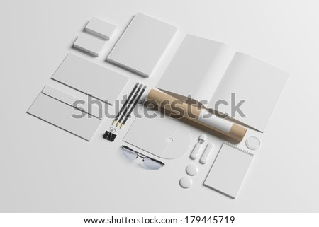 Blank stationery set isolated on white. Consist of book, note, magazine, business cards, pencil, cd disk, buttons, envelopes, tubus. - stock photo