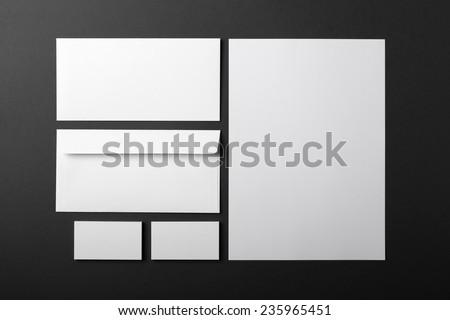 blank stationery set on dark grey background - stock photo
