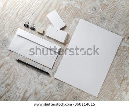 Blank stationery set on light wooden background. Mock-up for ID. Template for design presentations and portfolios. Top view.