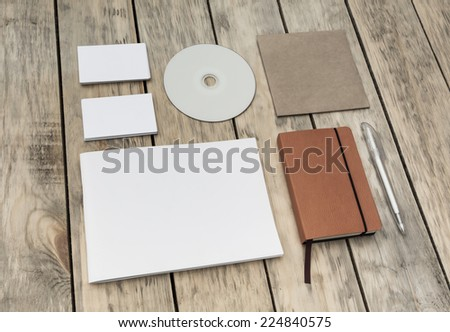 Blank stationery set on old wood background: business cards, booklet, notebook, notepad, CD, box and pen. Vintage style - stock photo