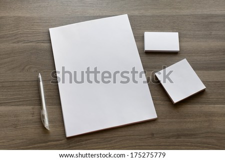 Blank stationery set on wood background / a4 paper, business cards, booklet, sheets and pen - stock photo