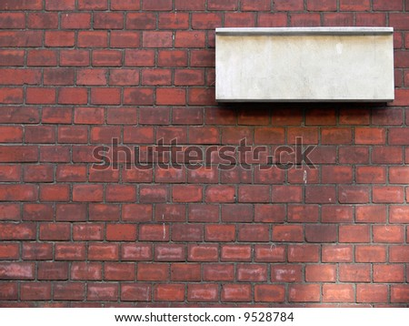 Blank stone tablet on the brick wall - stock photo