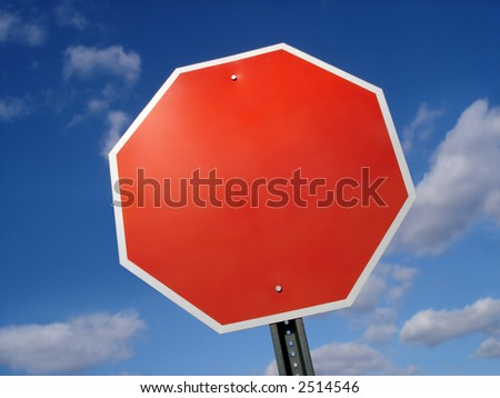 Blank stop sign frame against blue sky. - stock photo