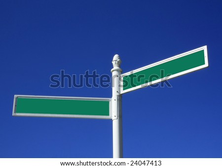 Blank street sign against a blue sky - stock photo