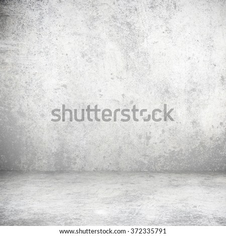 Blank stucco grey wall and floor interior in shadow  - stock photo