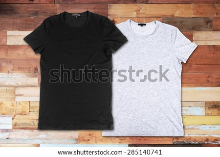 Blank t-shirts on a wooden surface