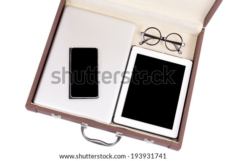 blank tablet, mobile and electronic devices in briefcase - stock photo