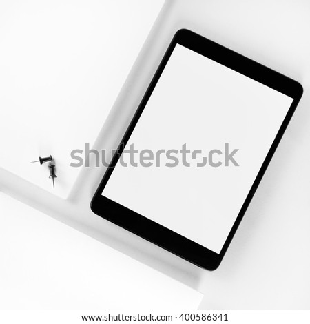 Blank tablet pc on white paper background. Mockup for design presentations and portfolios. Top view. - stock photo